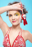 Beautiful girl with lollipop. Portrait of beautiful slavonic girl posing with red bunny-lollipop Royalty Free Stock Photos