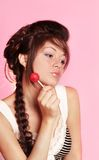 Beautiful girl with  lollipop. Young beautiful female teenager with creativity hairstyle Stock Photo