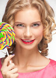 Beautiful girl with lollipop. Portrait of beautiful girl with blond curly hair holding lollipop Stock Photos