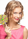 Beautiful girl with lollipop. Portrait of beautiful girl with blond curly hair holding lollipop Royalty Free Stock Photo
