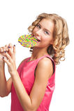 Beautiful girl with lollipop. Portrait of beautiful girl with blond curly hair eating lollipop Royalty Free Stock Photo