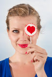 Beautiful girl with lollipop heart in her hand. Portrait beautiful young blond girl with lollipop heart in her hand Stock Photos