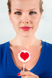 Beautiful girl with lollipop heart in her hand Stock Photo