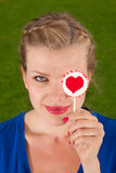 Beautiful girl with lollipop heart in her hand. Portrait beautiful young blond girl with lollipop heart in her hand Stock Photo