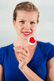Beautiful girl with lollipop heart in her hand. Portrait beautiful young blond girl with lollipop heart in her hand Stock Images