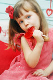 Beautiful girl with lollipop. Beautiful girl holding a lollipop in the shape of heart Royalty Free Stock Photography
