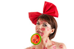 Beautiful girl with lollipop in mouth in lipstick kisses Stock Photos