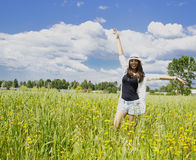 Beautiful girl lonely in a field Stock Photography