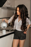 Beautiful girl with long black curly hair in the stock photos