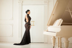 Beautiful girl in a long black dress stock images