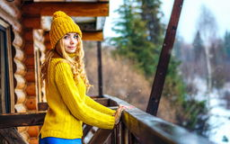 Beautiful girl with long blond curly hair in a knit sweater and hat Stock Photo