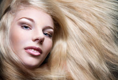 Beautiful girl with long blond hair Royalty Free Stock Photo