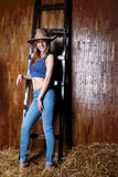 Beautiful girl with long blond hair wearing cowboy hat Royalty Free Stock Image