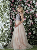 Beautiful girl with long blonde hair posing against floral background. Stock Photo