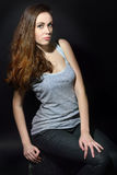 Beautiful girl with long brown hair in casual clothes Stock Images