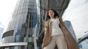 Fashionable Asian woman posing in the city center
