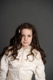 Beautiful  girl with long curly hair Royalty Free Stock Photos