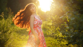 Beautiful girl with long curly hair. Evening Stock Photography