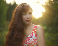 Beautiful girl with long curly hair. Evening Stock Images