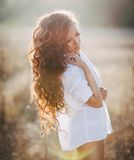 Beautiful girl with long curly hair Royalty Free Stock Image