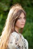 Beautiful girl with long dark hair Stock Photos