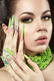 Beautiful girl with long green fingernails and bri Stock Photos