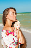 Beautiful girl with long hair on the beach with se Royalty Free Stock Photo