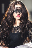 Beautiful girl with long hair in blindfold Stock Images