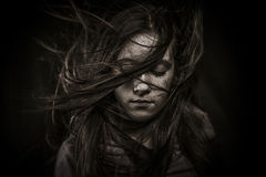 Beautiful girl with long hair, developing Royalty Free Stock Photo