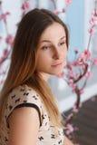 Beautiful girl with long hair in flowering garden Stock Photos
