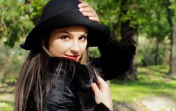 Beautiful girl with long hair and a hat Stock Image