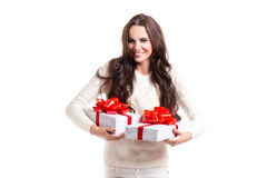 Beautiful girl with long hair holding two gift boxes. Royalty Free Stock Photography