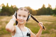 Beautiful girl with long hair listening song Stock Images