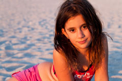 Beautiful girl with long hair lit by the sunset Royalty Free Stock Photos