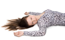 Beautiful girl with long hair lying on the floor Royalty Free Stock Photos