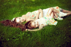 Beautiful girl with long hair lying next to his pregnant mother royalty free stock photos