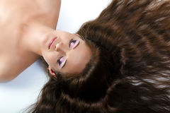 Beautiful girl with long hair and make-up Royalty Free Stock Photos