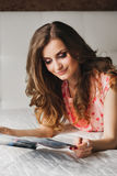 Beautiful girl with long hair in pajamas Stock Photography