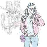 A beautiful girl with long hair in sunglasses, a jacket, a T-shirt and jeans. Fashion and style, clothing and accessories. Vector illustration Royalty Free Stock Image