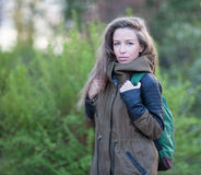 Beautiful Girl Long Hair. Tourist jacket, Backpack. Royalty Free Stock Photography