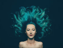 Beautiful girl with long hair of turquoise color Royalty Free Stock Photos