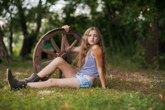 Beautiful girl with long hair  in the village Royalty Free Stock Images
