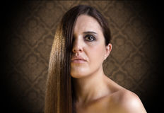 Beautiful girl with long hair on vintage background royalty free stock images