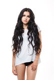 Beautiful girl with long hair and wearing a white Stock Photo