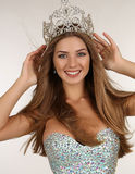 Beautiful girl with long hair wears luxurious dress and crown Stock Images