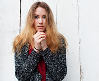 Beautiful girl with long hair in the winter is cold Stock Image