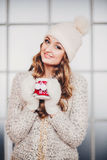 Beautiful girl with long hair in winter hat stock photo
