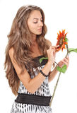 Beautiful girl with long hairs holding sunflower Stock Photos
