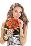 Beautiful girl with long hairs holding sunflower Royalty Free Stock Photography