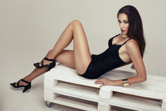 Beautiful girl with long legs. Beautiful girl with dark hair with long legs Stock Images